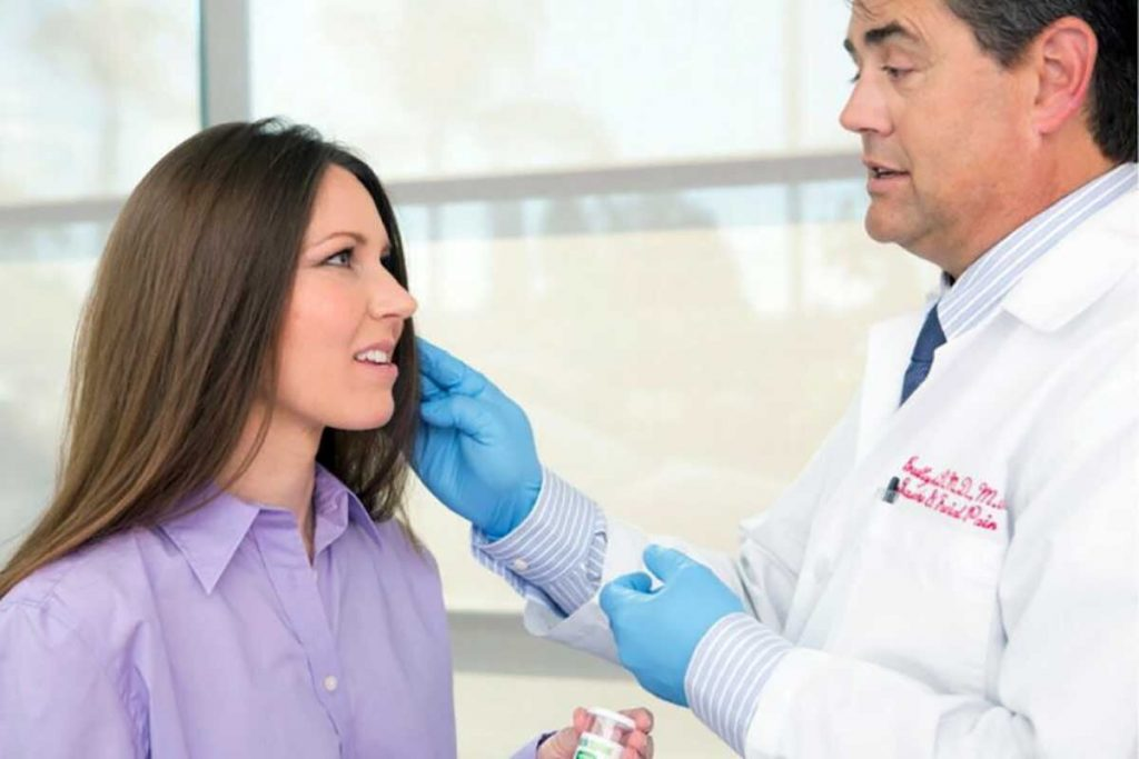 Dr. Brad Eli, DMD, MS helping a patient with jaw sprain and strain issues